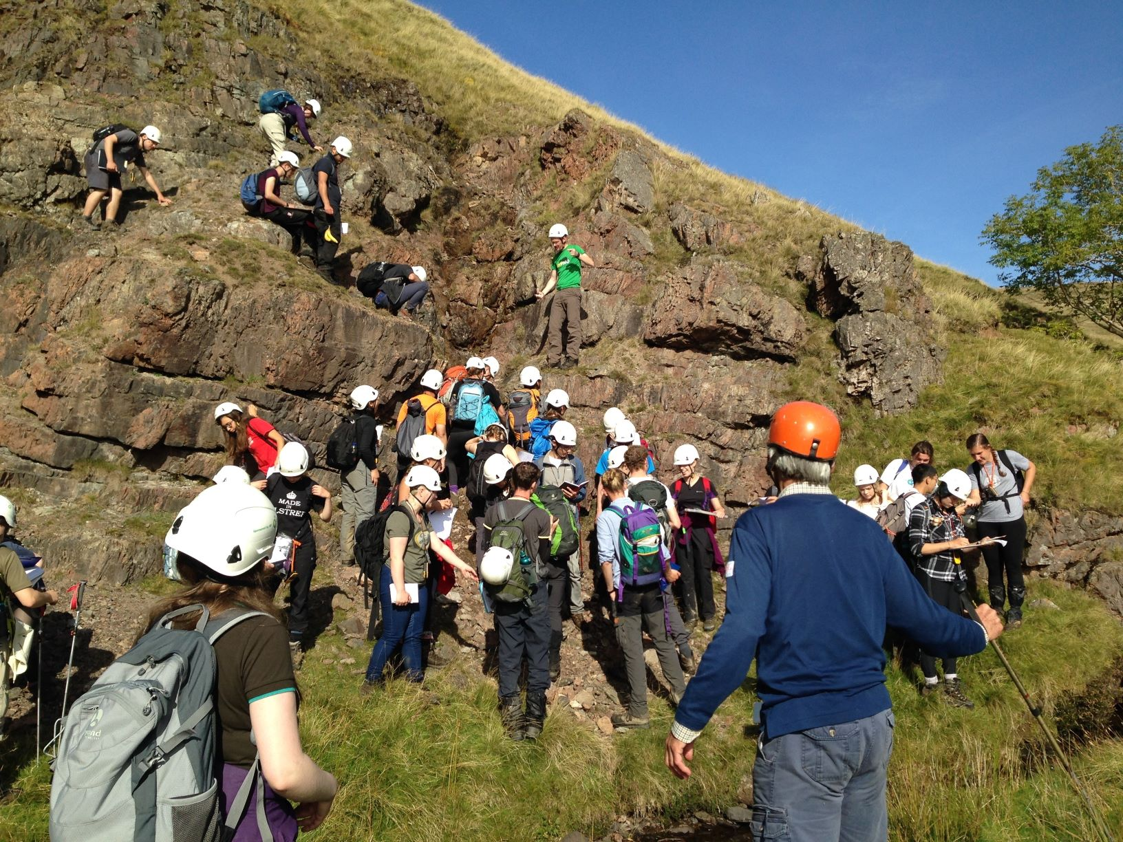 A Cambridge student party examines volcanic rocks in the Ordovician part of the Backside Beck section in 2016