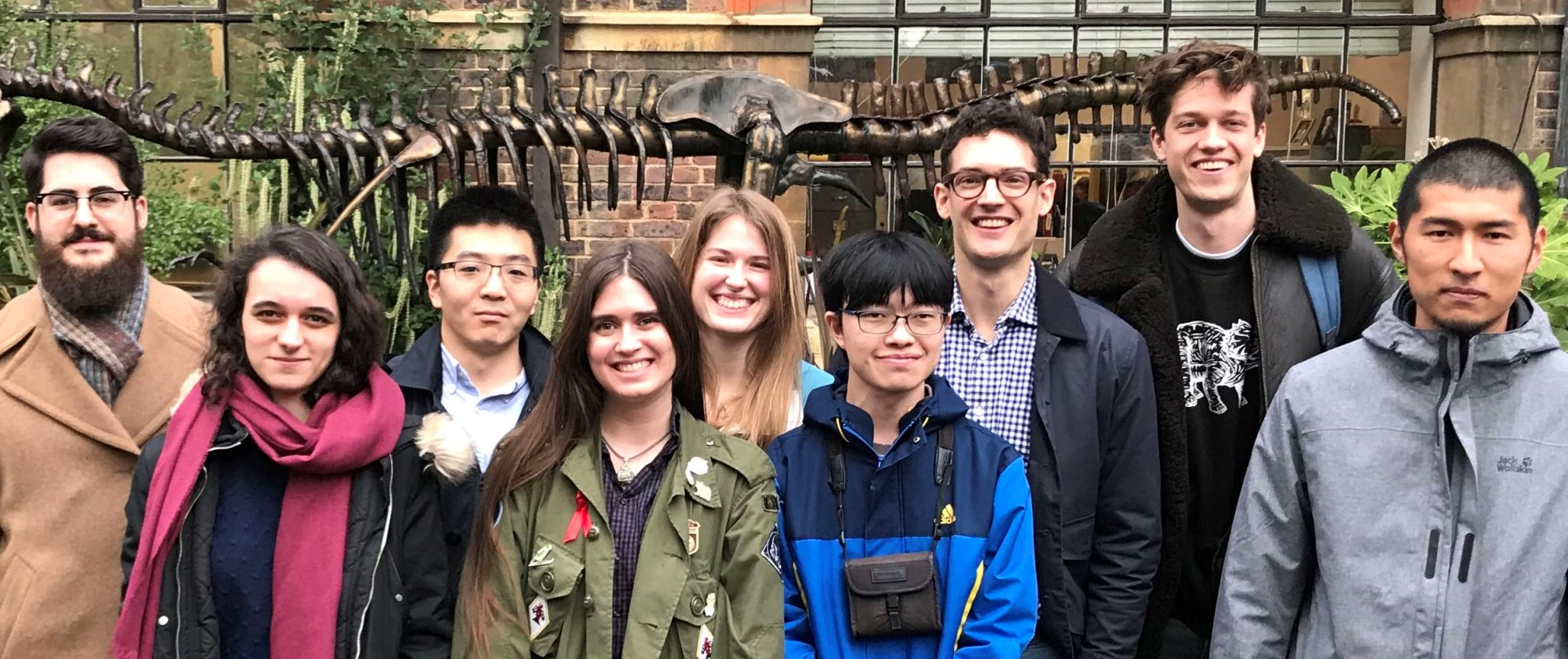 Image of Daniel Field, third from right, smiling with his research group