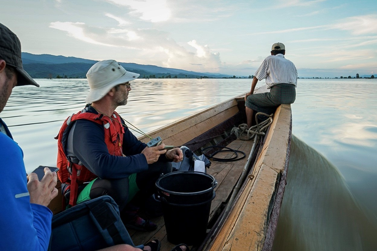 Photo of scientists sampling from a boat on the Irrawaddy River