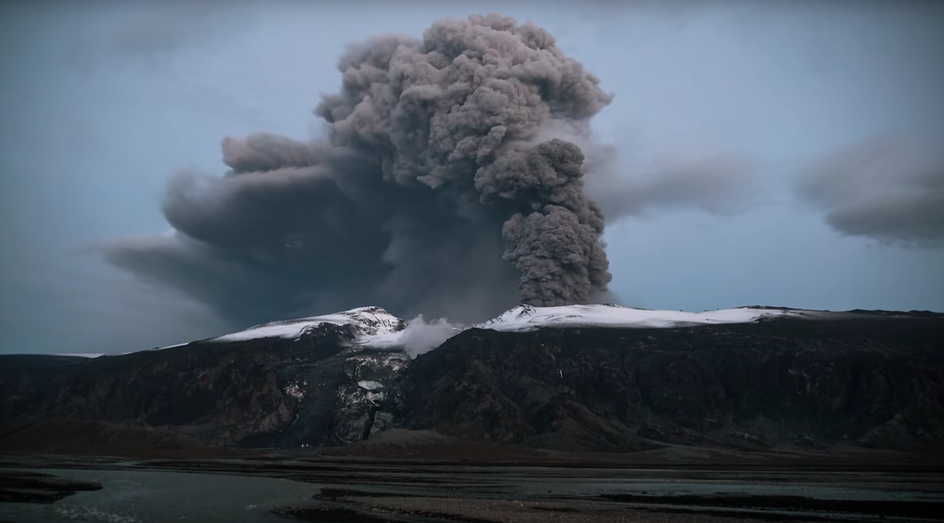 A photo of the  Eyjafjallajökull volcano erupting in 2010, producing a large plume of volcanic ash.