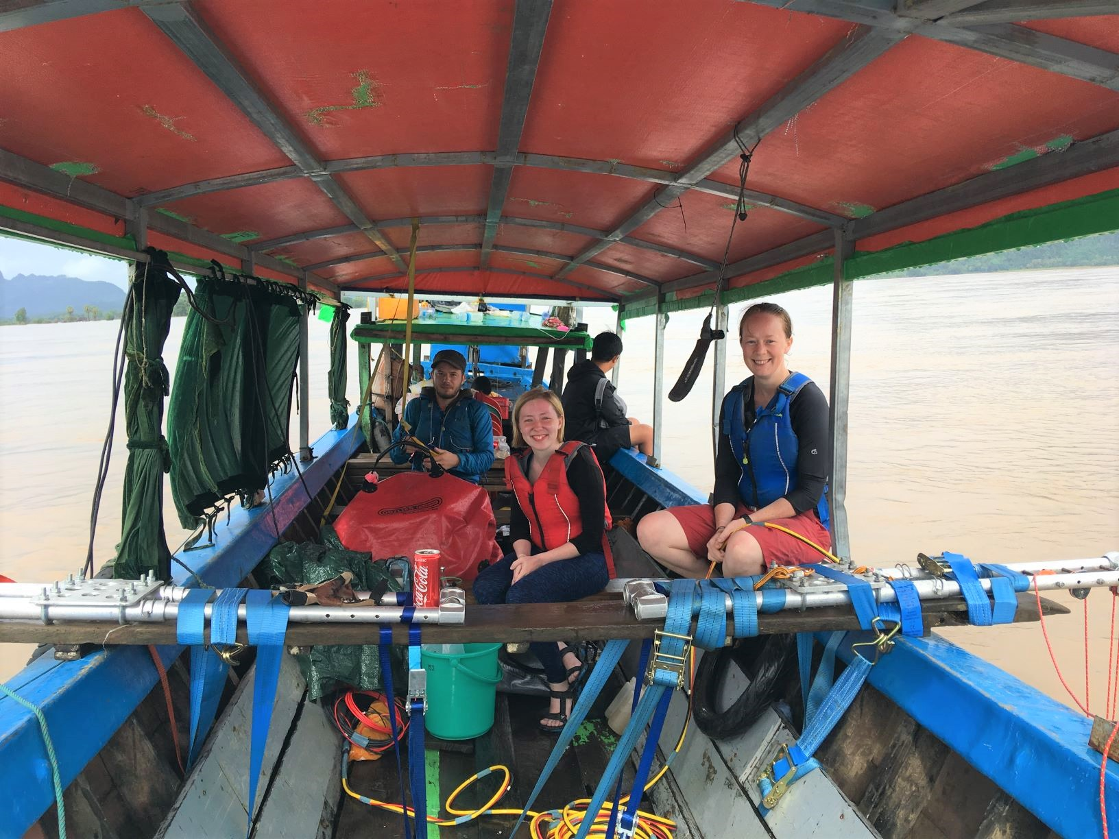 Image of Emily, Christina and Jotis on a boat sampling the Salween River