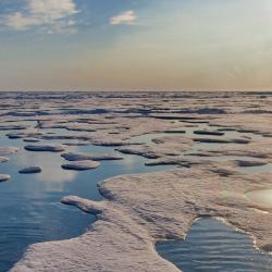 Image of melting sea ice under sunny sky