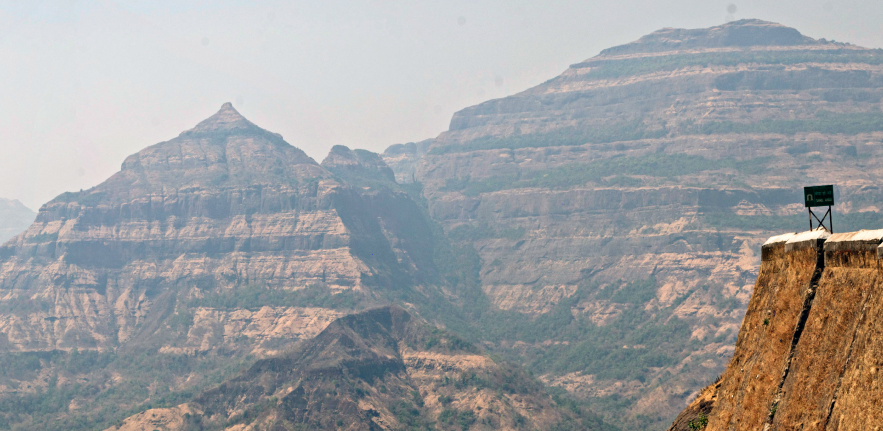 Image showing the profile of the Deccan Traps volcanic province in India - the rocks are horizontally striped with alternate light, dark layers of lava