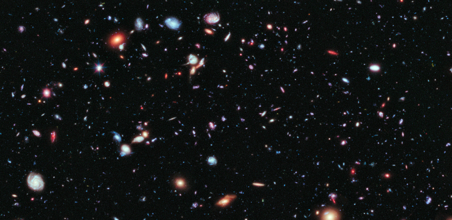 Image of our galaxy, showing colourful and distant planets and stars