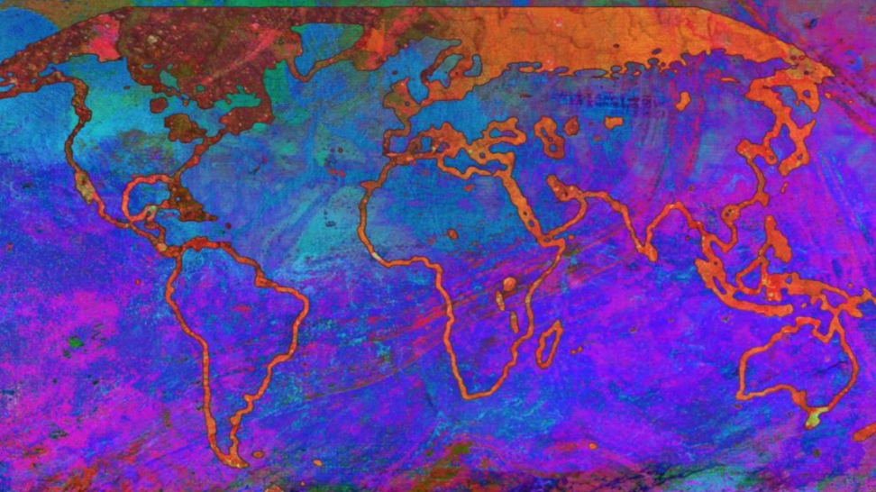 Abstract image showing a map of the world in blue/pink printed inks