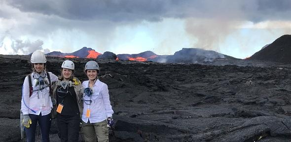 Penny and Emily in front of lava flows during the eruption of Kilauea in Summer 2018