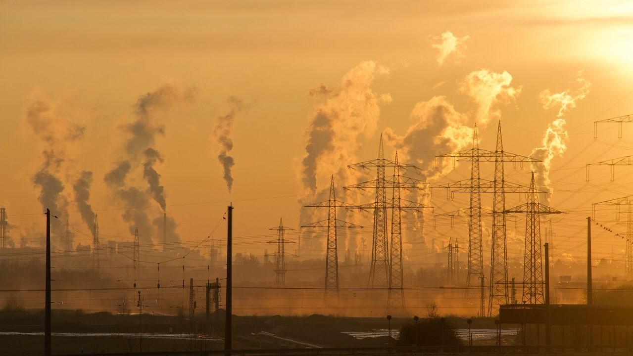 Image of sunset with smoke emitted from power stations